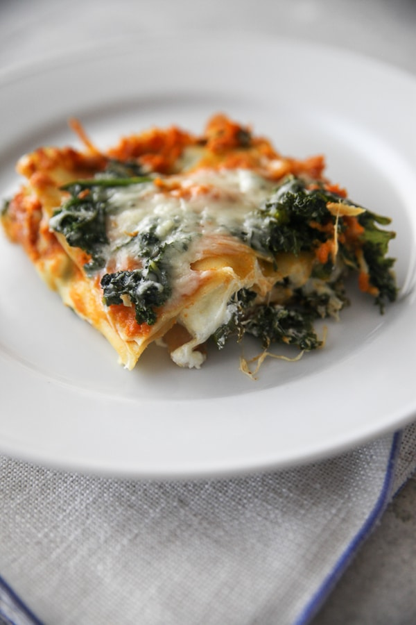 pumpkin goat cheese and kale lasagna on a plate