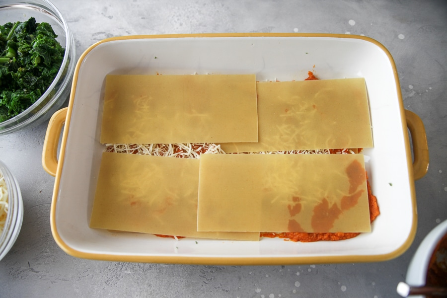 lasagna noodles on top of cheese and pumpkin