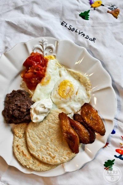 Salvadoran Breakfast plate of food with eggs, tortillas and plantains