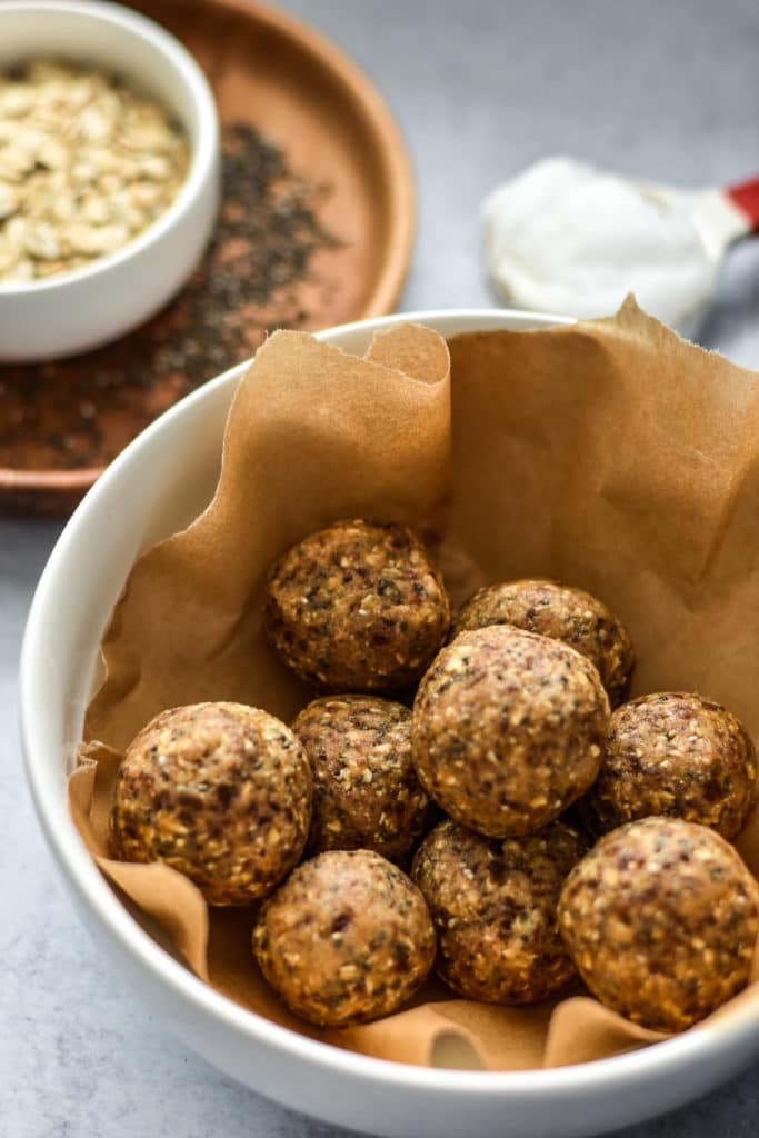 cookie dough balls in a container with brown paper