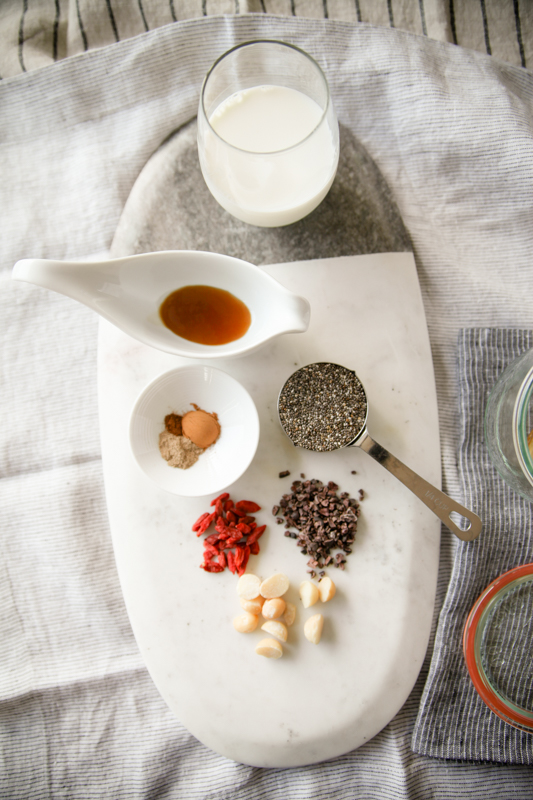 Maple Chai Chia Pudding ingredients on marble platter