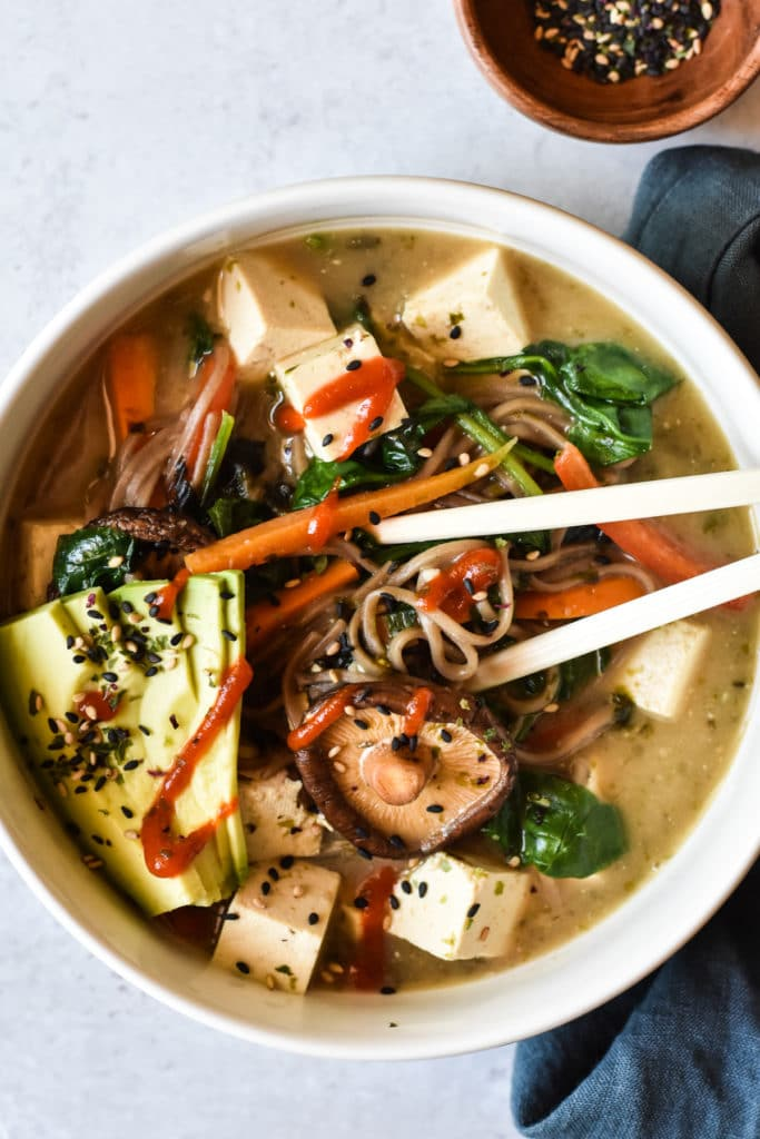 miso noodle soup in a bowl with chopsticks