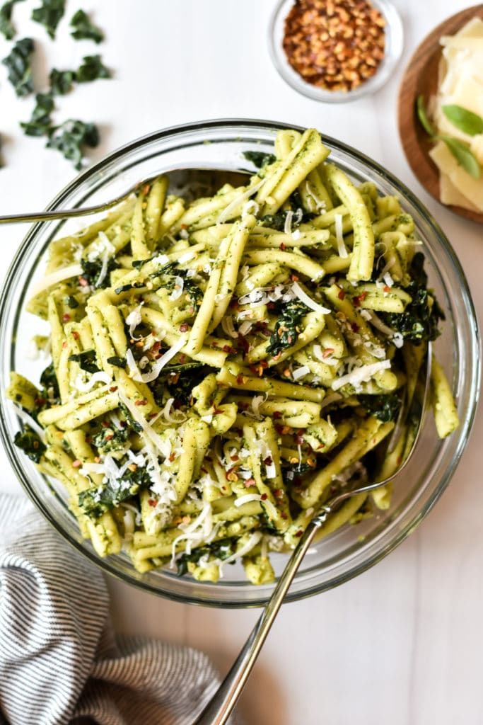 bowl of pasta salad with kale and pesto