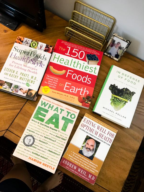 my 5 favorite nutrition books on a desk