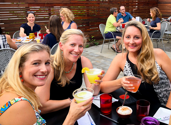 girls having cocktails at Bang! in Charlottesville, Virginia
