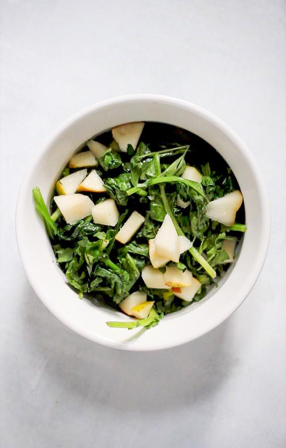 greens and pear in a ramekin