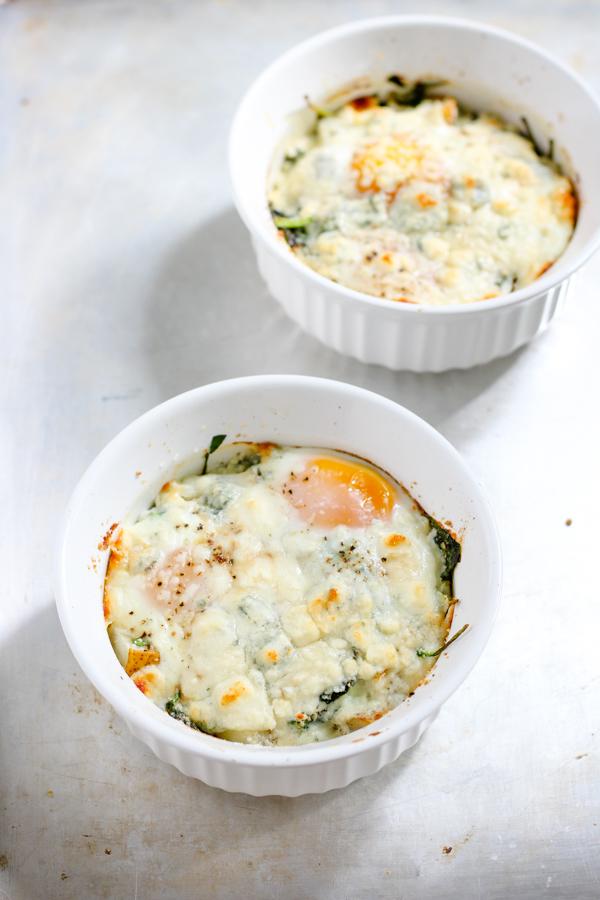 two ramekins of baked eggs