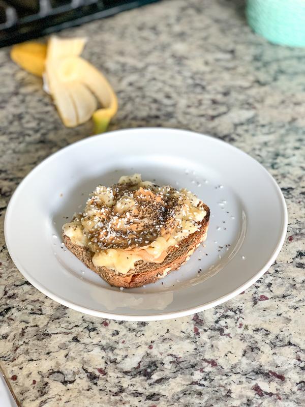 banana smash toast on white plate