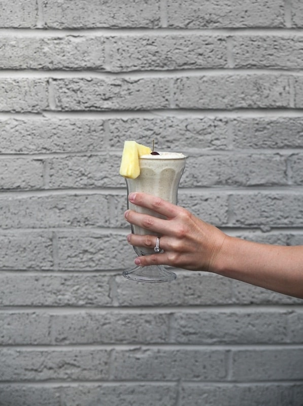 pineapple smoothie on gray wall