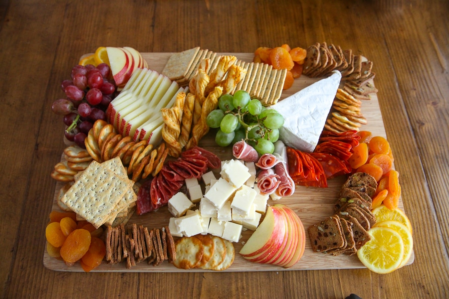 Thanksgiving Charcuterie Board - add in layers of crackers