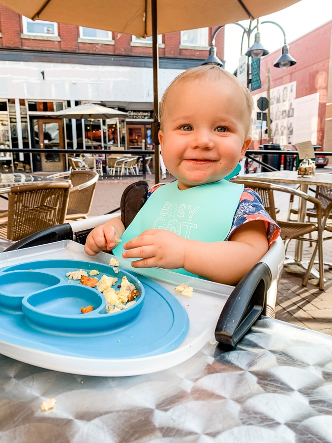 baby in a restaurant with ezpz plate