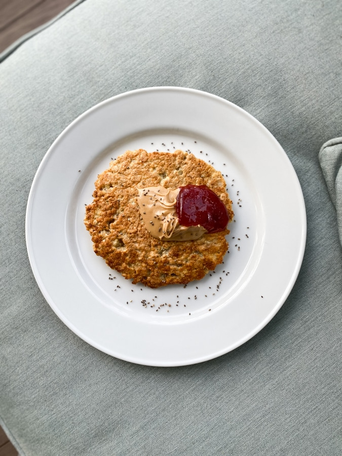 oatmeal pancake on cloth background with peanut butter and jelly