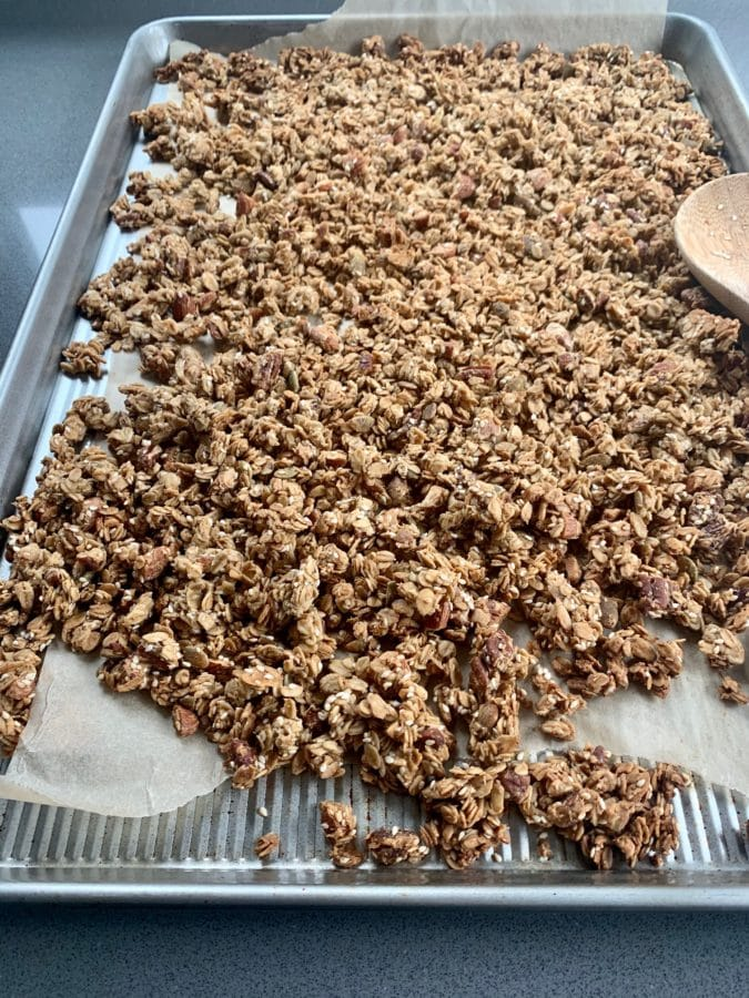 Full stainless steel sheet pan of Crunchy Tahini Granola.