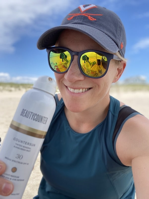 beautycounter sunscreen mist and Kath in hat