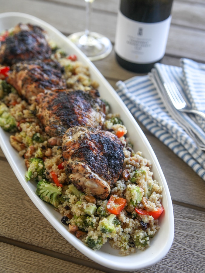 a long plate with quinoa salad and chicken with wine