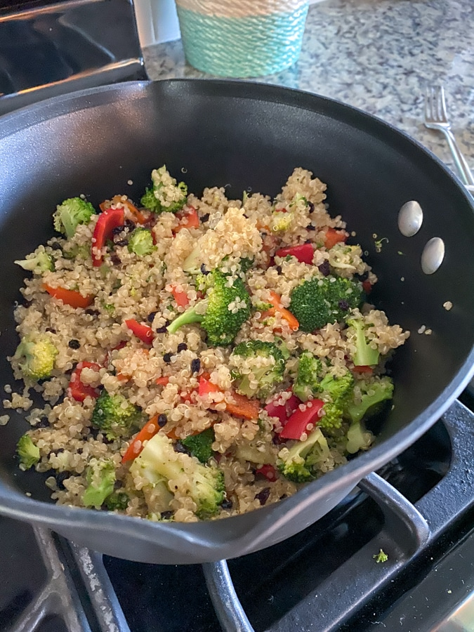 quinoa and veggies cooking in a pot