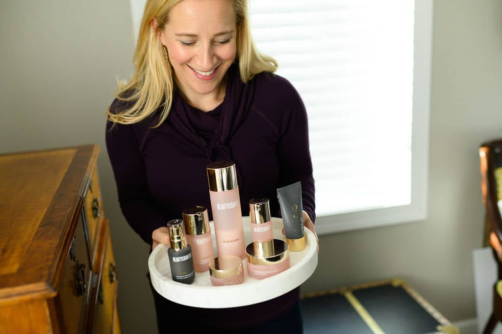 Kath bringing Countertime anti-aging clean beauty products on a tray