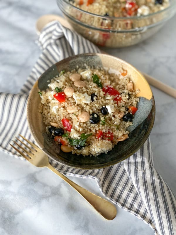 quinoa salad with gold fork and napkin