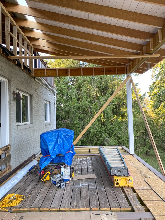 porch under construction with partial roof