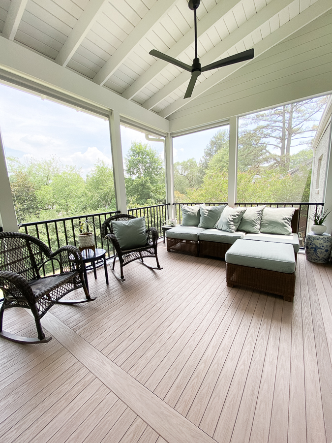 tongue and groove wolf composite flooring in weathered ipe on screened in porch