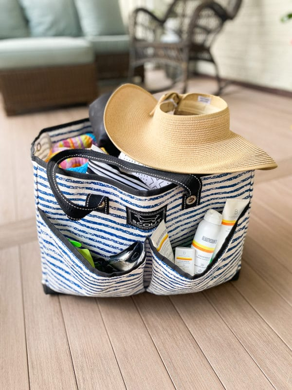 close up of Scout BJ bag packed for the pool with a sun hat on top