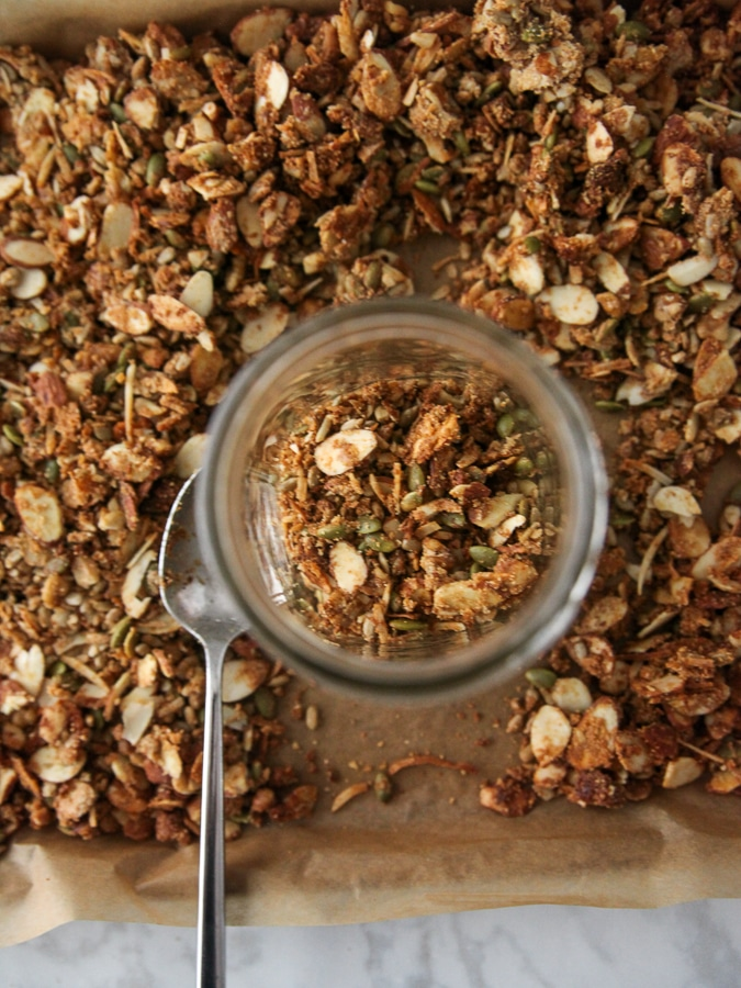 granola in a jar on a baking sheet