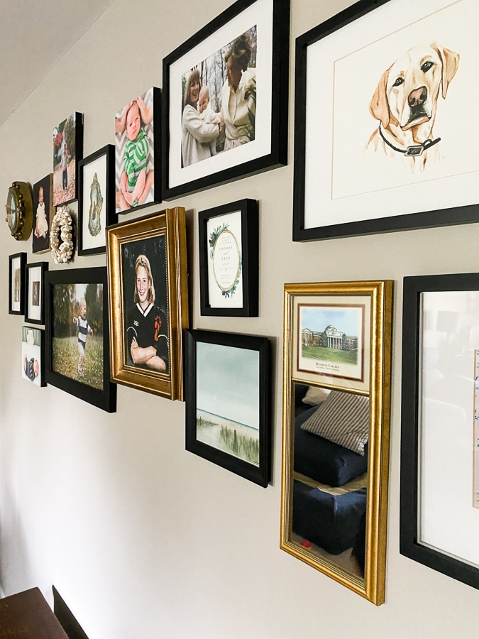 gold mirrors and frames in a gallery wall