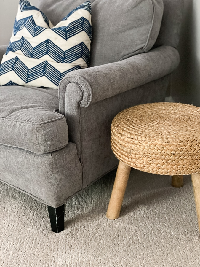 Grey chair with natural woven stool.