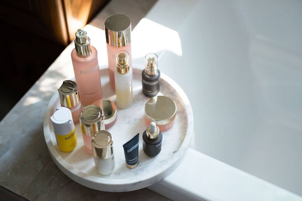 Round marble tray with a variety of Beautycounter skincare products.