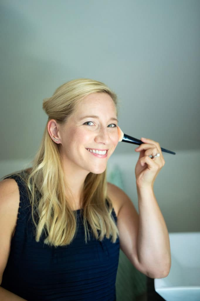 kath putting on beautycounter blush