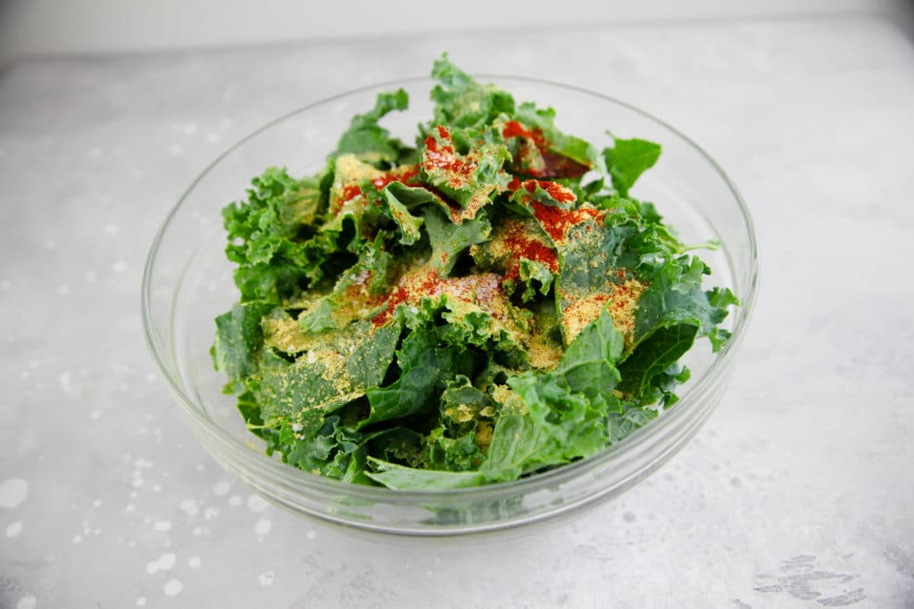 bowl of kale with seasonings