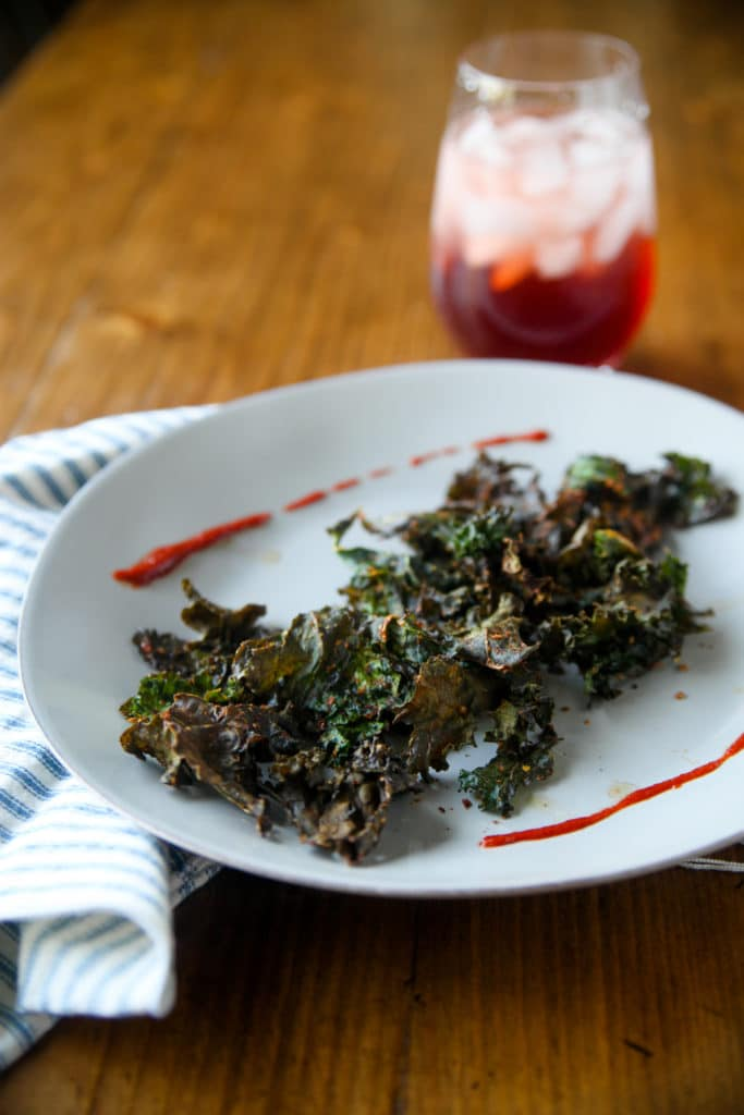 crunchy kale chips on a plate