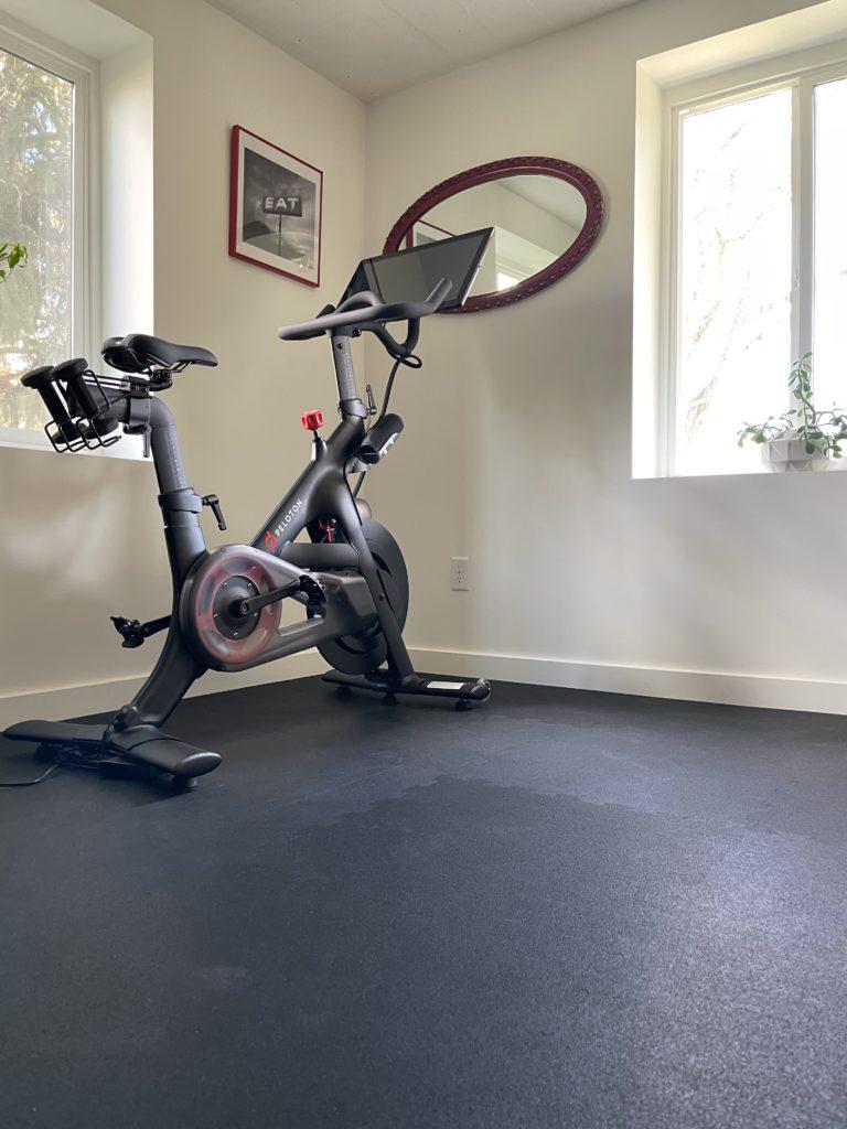 Peloton bike in a home gym