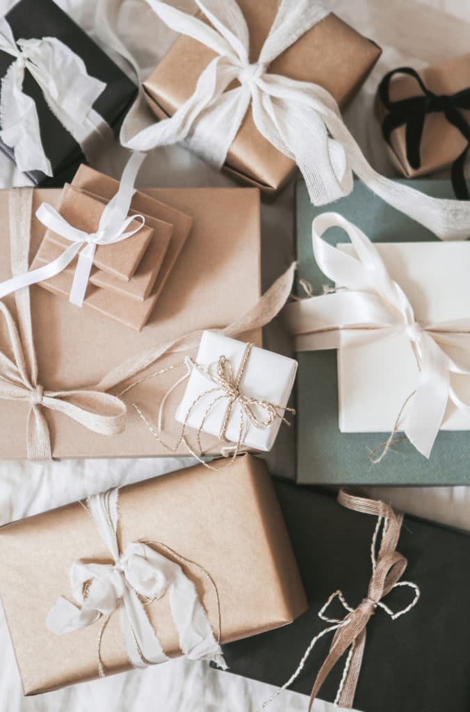 array of packages in cream and green with white ribbons