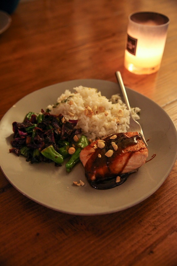 salmon with sauce and rice by candlelight