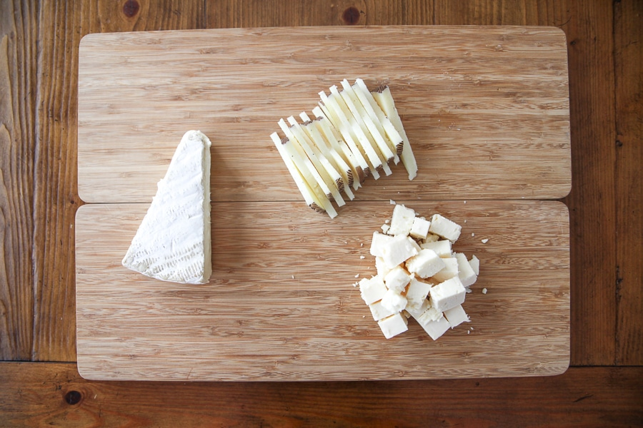 cheeses on a cutting board