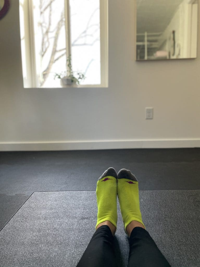 socks on a yoga mat in a fitness room