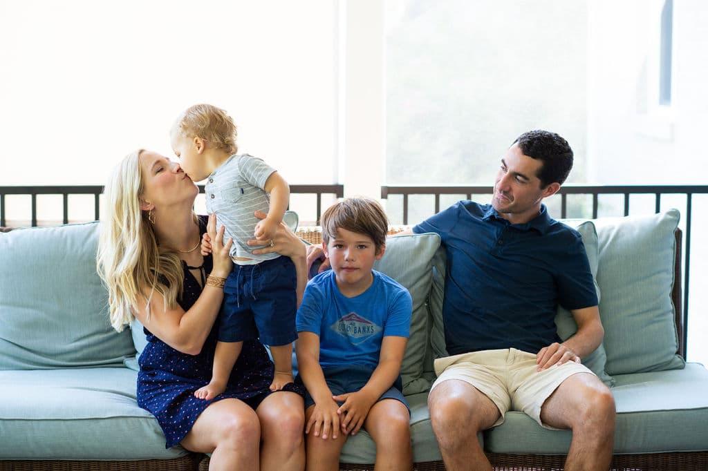 Kath and family on a blue sofa