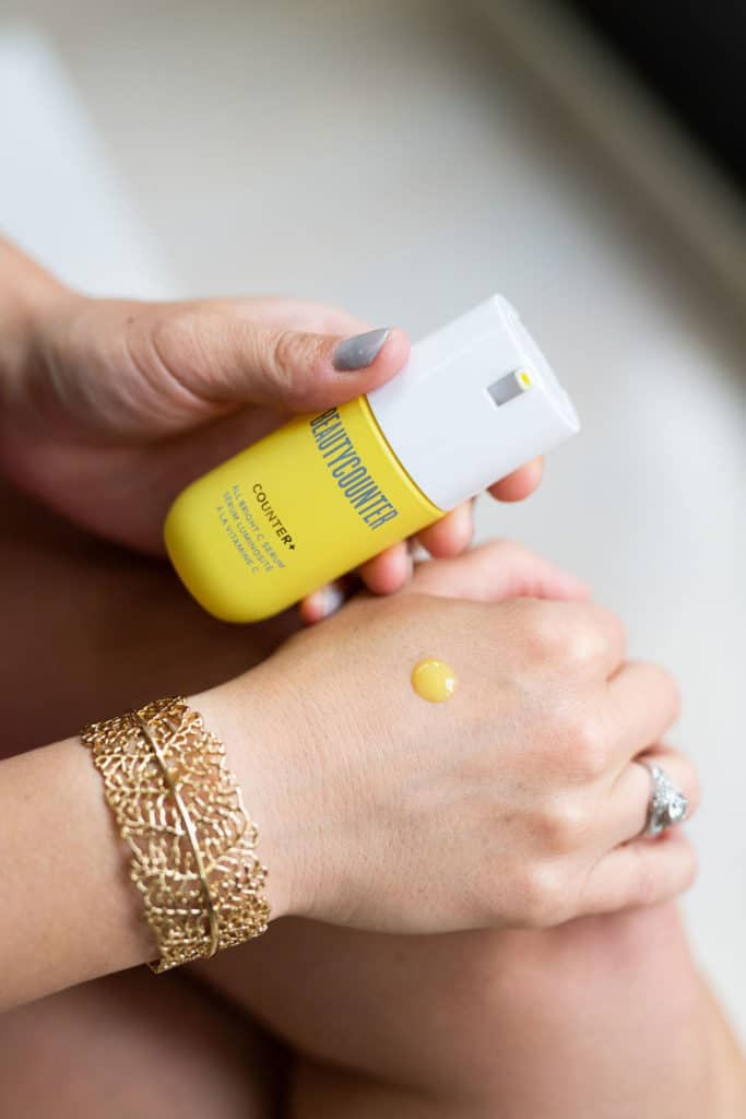 Beautycounter all bright c serum dot on hand with bottle