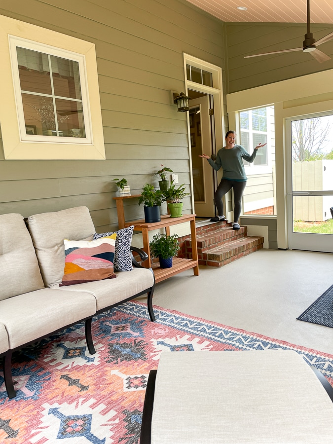cozy screened in porch with greens and coral
