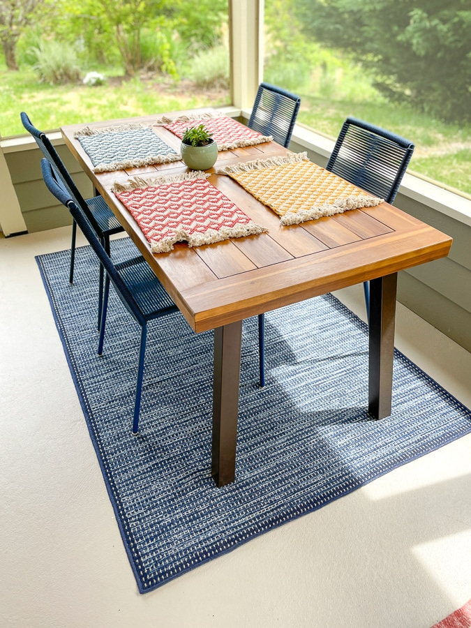 wayfair table with colorful placemats from the happy cook and navy blue rug