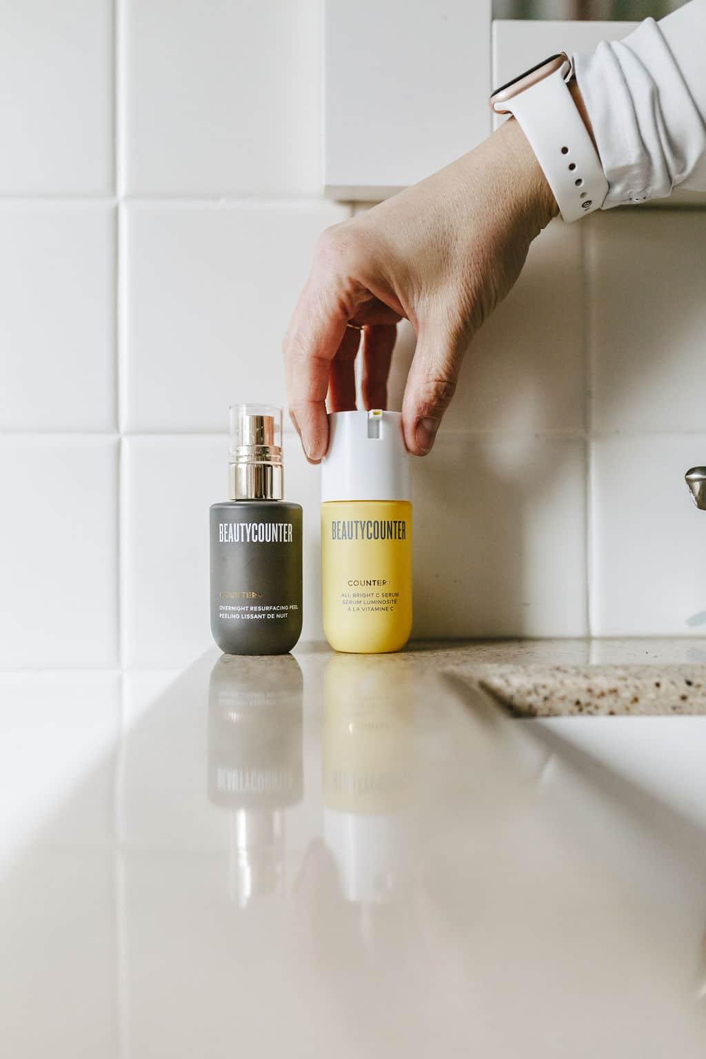 Overnight Resurfacing Peel & All Bright C Serum on bathroom counter