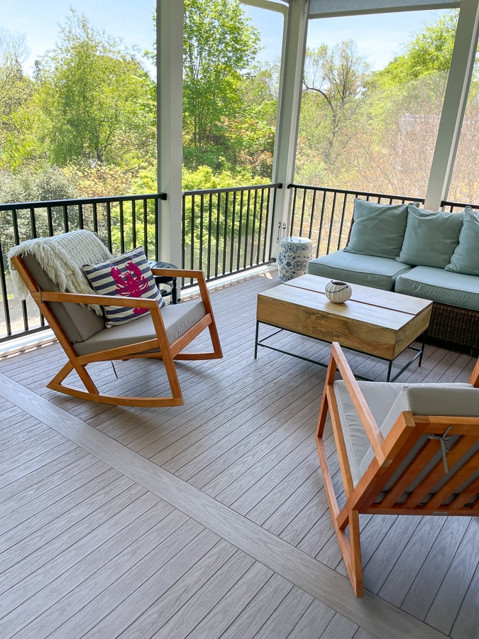 screened porch with rocking chairs