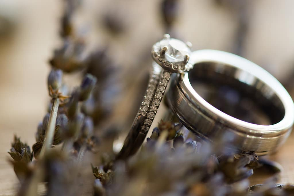 two wedding rings on lavendar