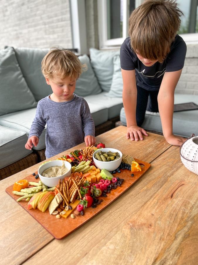 two boys enjoying Kids Charcuterie Board