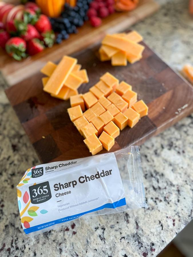 cheese cubes on a cutting board