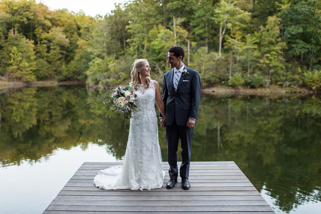 kath and thomas standing on a dock