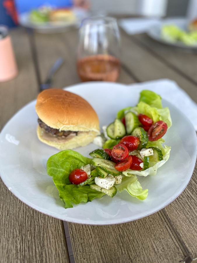 burger and salad on white plate