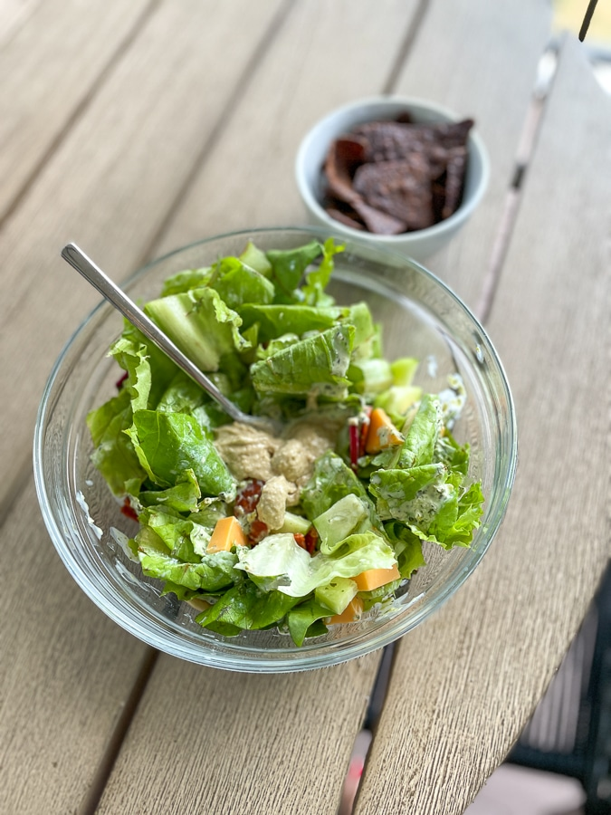 green salad in clear bowl