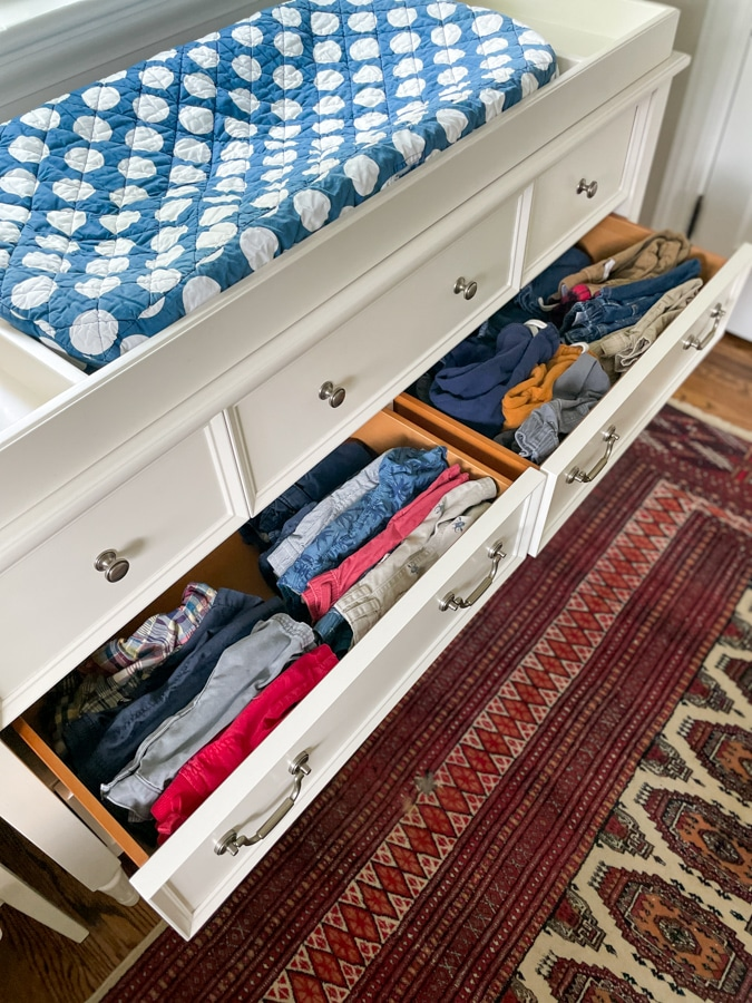kids shorts and pants organized in a drawer